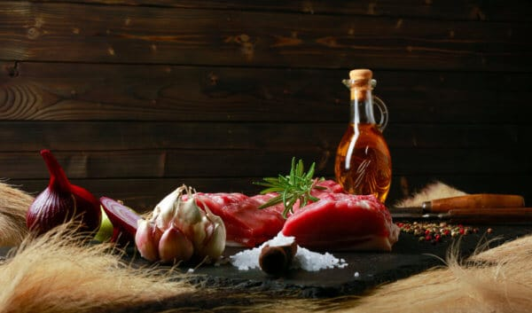 Detail,Raw,Wild,Boar,Meat,On,A,Black,Plate,With